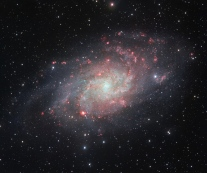 The VLT Survey Telescope (VST) at ESO's Paranal Observatory in Chile has captured this beautifully detailed image of the galaxy Messier 33, often called the Triangulum Galaxy. This nearby spiral, the second closest large galaxy to our own galaxy, the Milky Way, is packed with bright star clusters, and clouds of gas and dust. This picture is amongst the most detailed wide-field views of this object ever taken and shows the many glowing red gas clouds in the spiral arms with particular clarity.